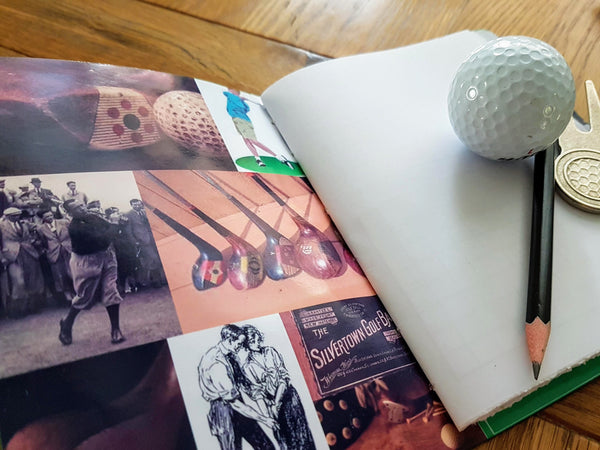 Golf clubs and vintage golf images inside leather cover of golfing journal