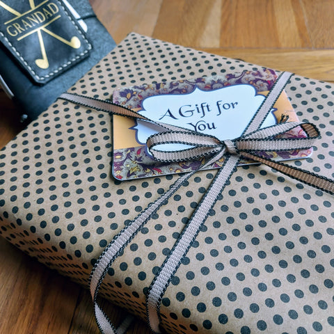Bespoke Bindery gift wrap in Kraft paper and black dots trimmed with ribbon