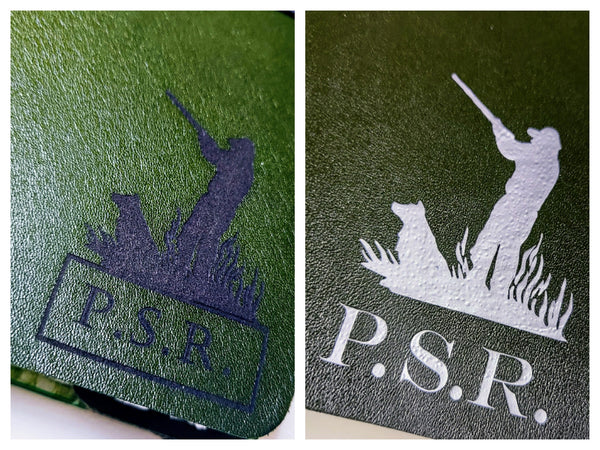 laser engraved and silver metallic hot foil hunter shooter logo with personalised initials on front cover of hunting shooting journal