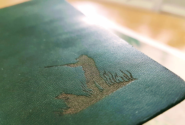 Hunting Shooting journal in glossy green spanish leather showing laser engraved man and dog shooting