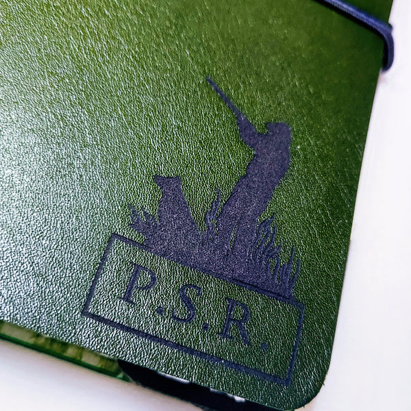 laser engraved hunter shooter logo with personalised initials on front cover of hunting shooting journal