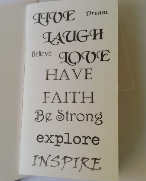 Inspirational text covered junk journal in standard size with words Live, Laugh, Love, Dream, Have Faith, Be Strong, Explore, Inspire in a variety of fonts