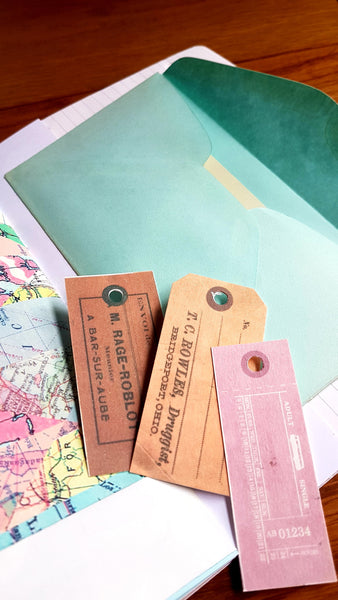 Vintage envelope and price tag ephemera inside Naked Junk Journal by Bespoke Bindery