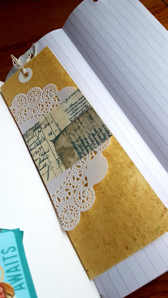 Doily  and Vintage  paper tag ephemera inside Naked Junk Journal by Bespoke Bindery