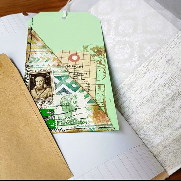 handmade tag for junk journal with scrapbook paper and postage stamps