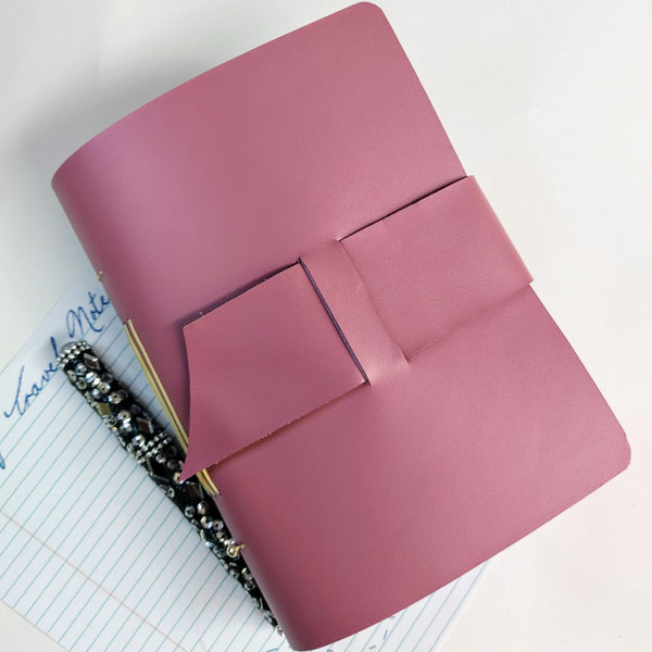 Front view Semi Gloss lilac leather travel journal with wide strap hand stitced spine and 2 silver beads with jewel encrusted pen