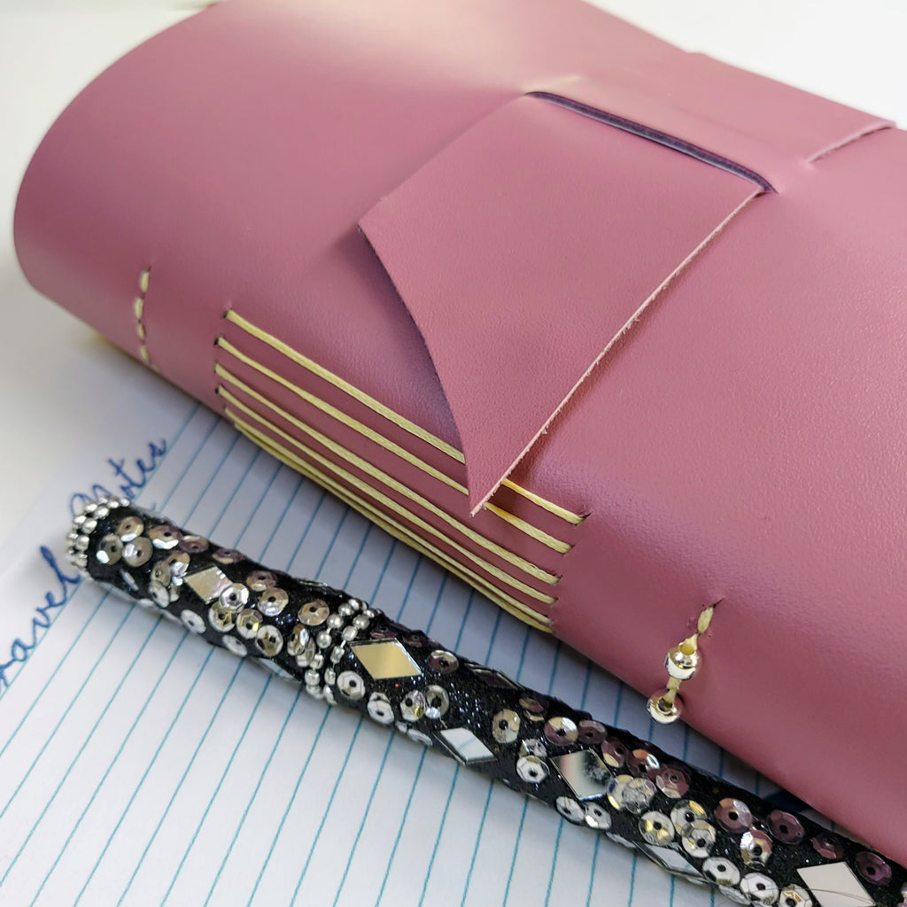 Semi Gloss lilac leather travel journal with wide strap hand stitced spine and 2 silver beads with jewel encrusted pen