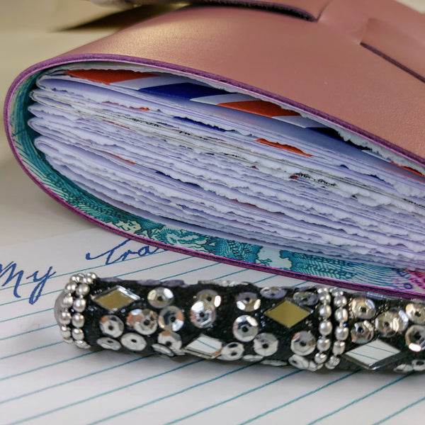 End view showind hand torn pages of Semi Gloss lilac leather travel journal  jewel encrusted pen