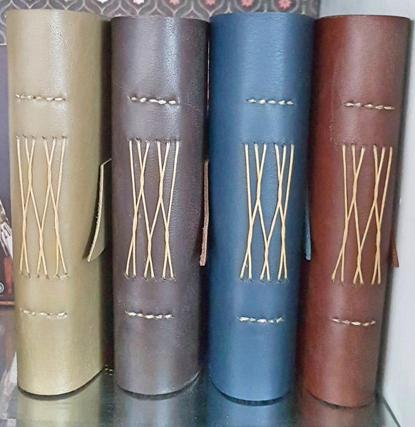 Handstitched spines of leather journal memoir in 4 colours