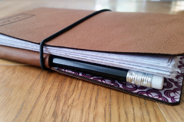 Leather golf journal with pencil pocket and elastic fastener loop