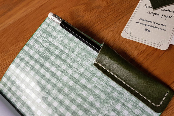 check lined hunting journal with handstitched leather pocket for pencil or pen