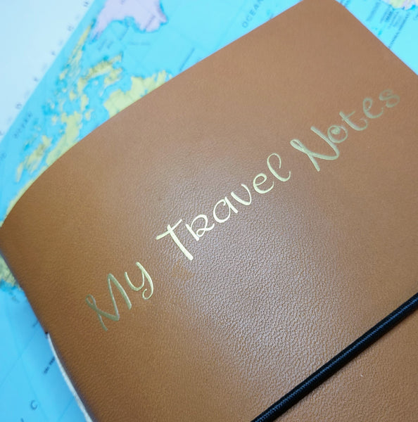 My Travel Notes gold foil personalisatrion to front of golden brown leather TN cover