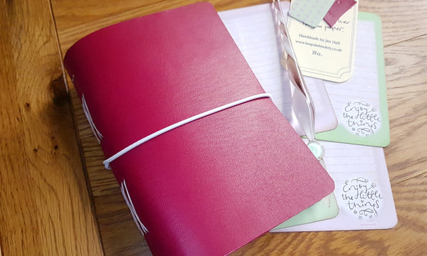 Cerise pink leather journal with lilac and green journal cards