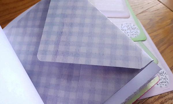 checked lilac envelope stitched into leather journal