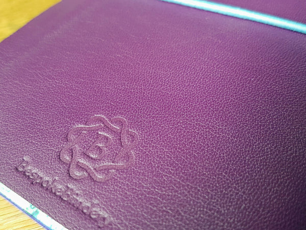 Purple plum spanish leather travel journal with Bespoke Bindery logo