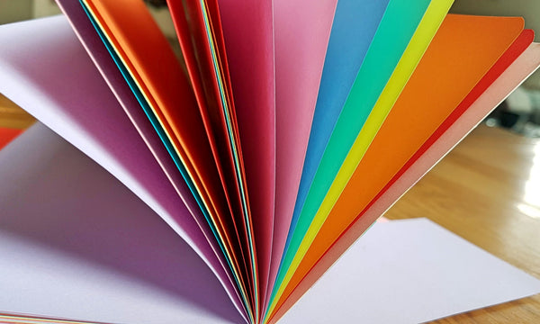 Bright rainbow coloured pages in Bespoke Bindery Rainbow Traveler's Notebook Insert