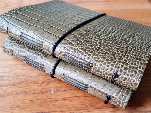 Snakeskin finish leather shooting journals in yellow green