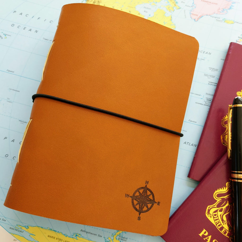 Golden Brown leather travel journal with laser etched compas logo