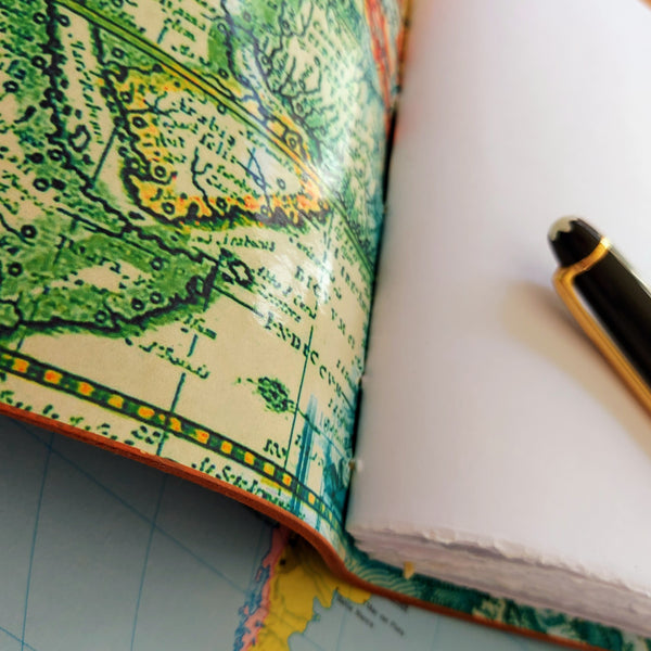 Abstract world map lining to leather travel journal showing slightly deckled edges to paper