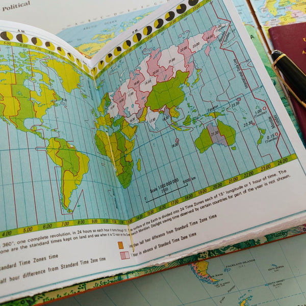 atlas page showing world time zone information in Bespoke Bindery bucket list travel notebook