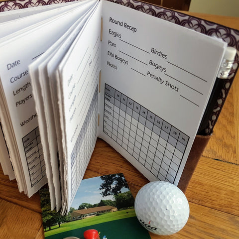 Golf Performance Tracker log in brown leather showing inside pages to record your golf score
