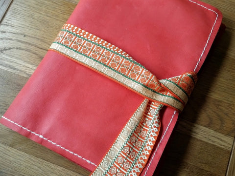 Hand stitched Coral Leather artist case with brocaid ribbon strap