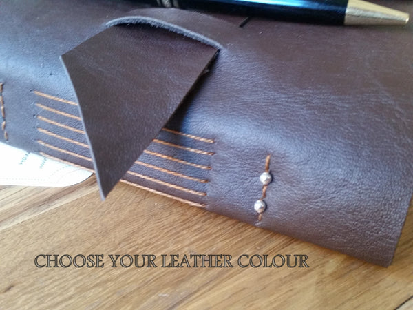 Leather travel journal with handstitched spine, decorative beads and wide strap