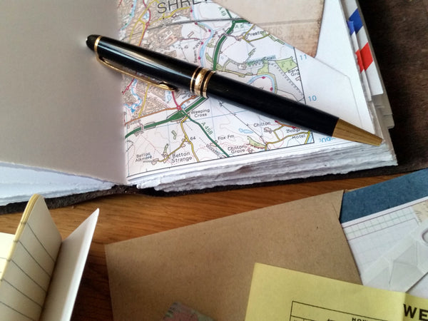 Travel journal with map tuck spot