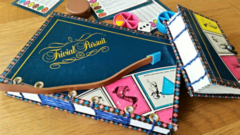 Trivial Pursuit coptic stitched hard cover notebook with leather bookmark trimmed with game piece and matching mini notebook