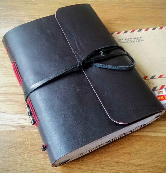 Dark leather wrap over cycling journal with beaded spine