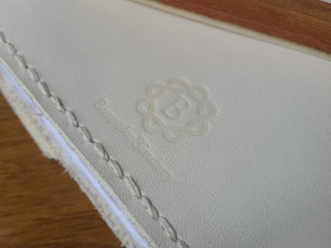 Bespoke Bindery Logo and hand stitched edge using double needle method