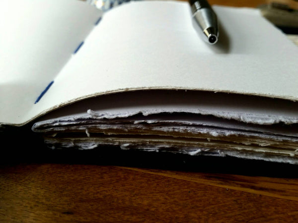 Leather journal showing hand torn pages