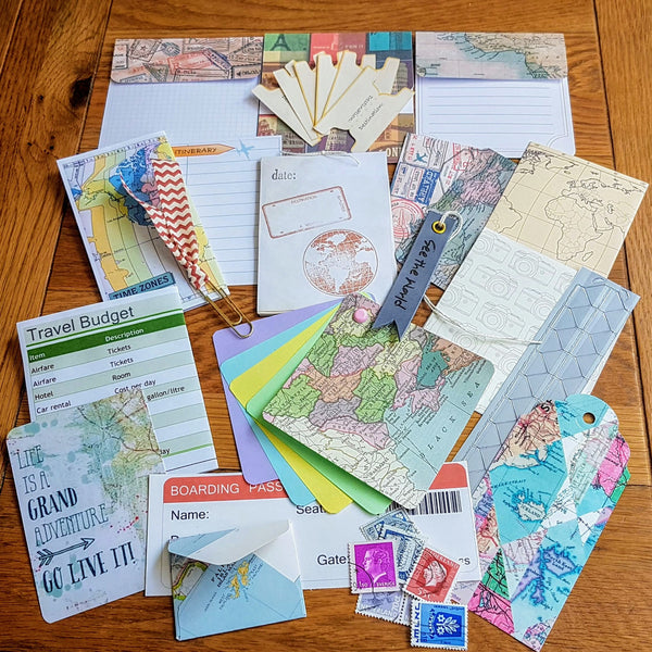 Mixed travel extras featuring travel related journal cards, stamps, map images, photo corners