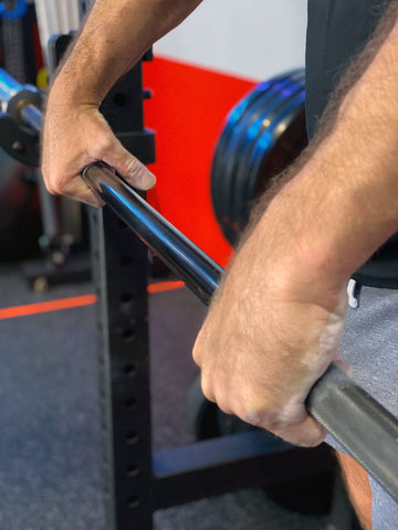 man false gripping barbell