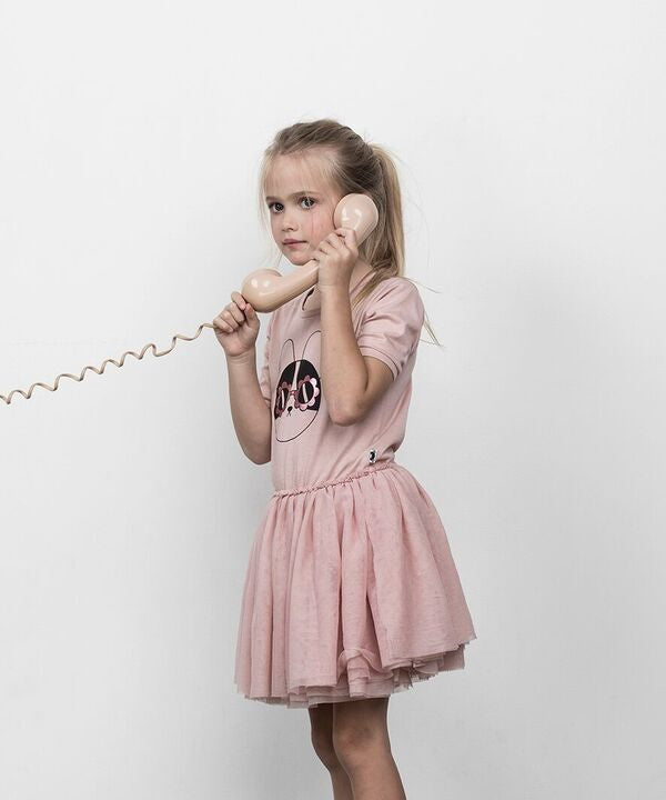Girl using phone in Huxbaby Flower Frenchie Ballet Dress