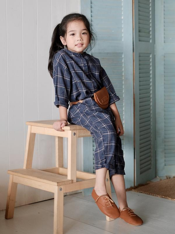 Girl wearing Laila & Lyra - Maddox Worker Jumpsuit (Navy)
