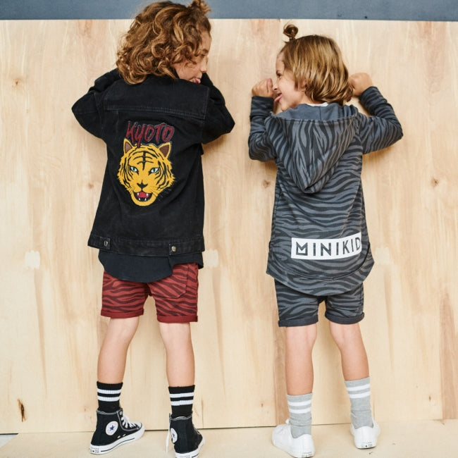 Two kids wearing MINIKID Kyoto collection apparel