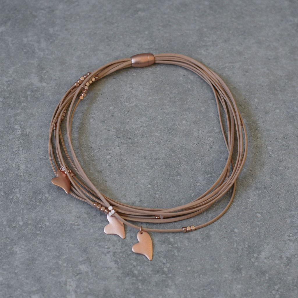 Nude Leather trimmed with Rose Gold Hearts