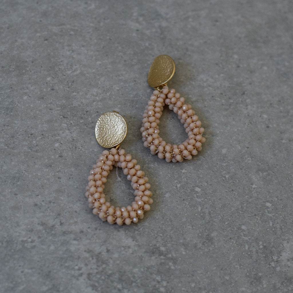 Teardrop Faceted Seed Beads in Nude with a textured soft matte gold stud