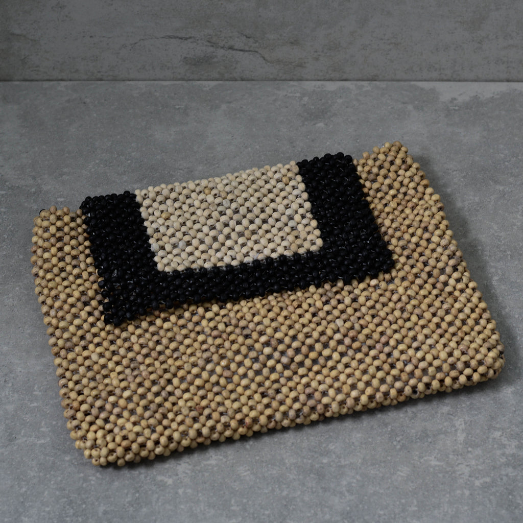 Wooden Bead in Natural Ivory and Black Clutch