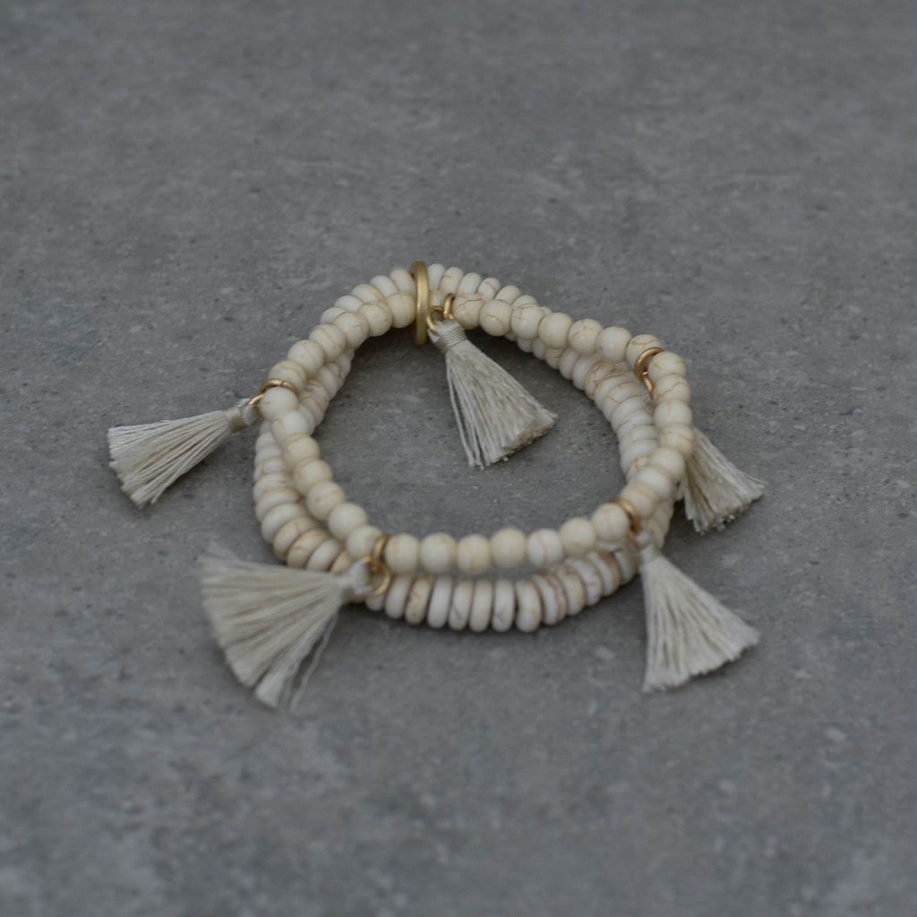 Natural Howlite Stretch Bracelets trimmed with ivory tassels and soft gold
