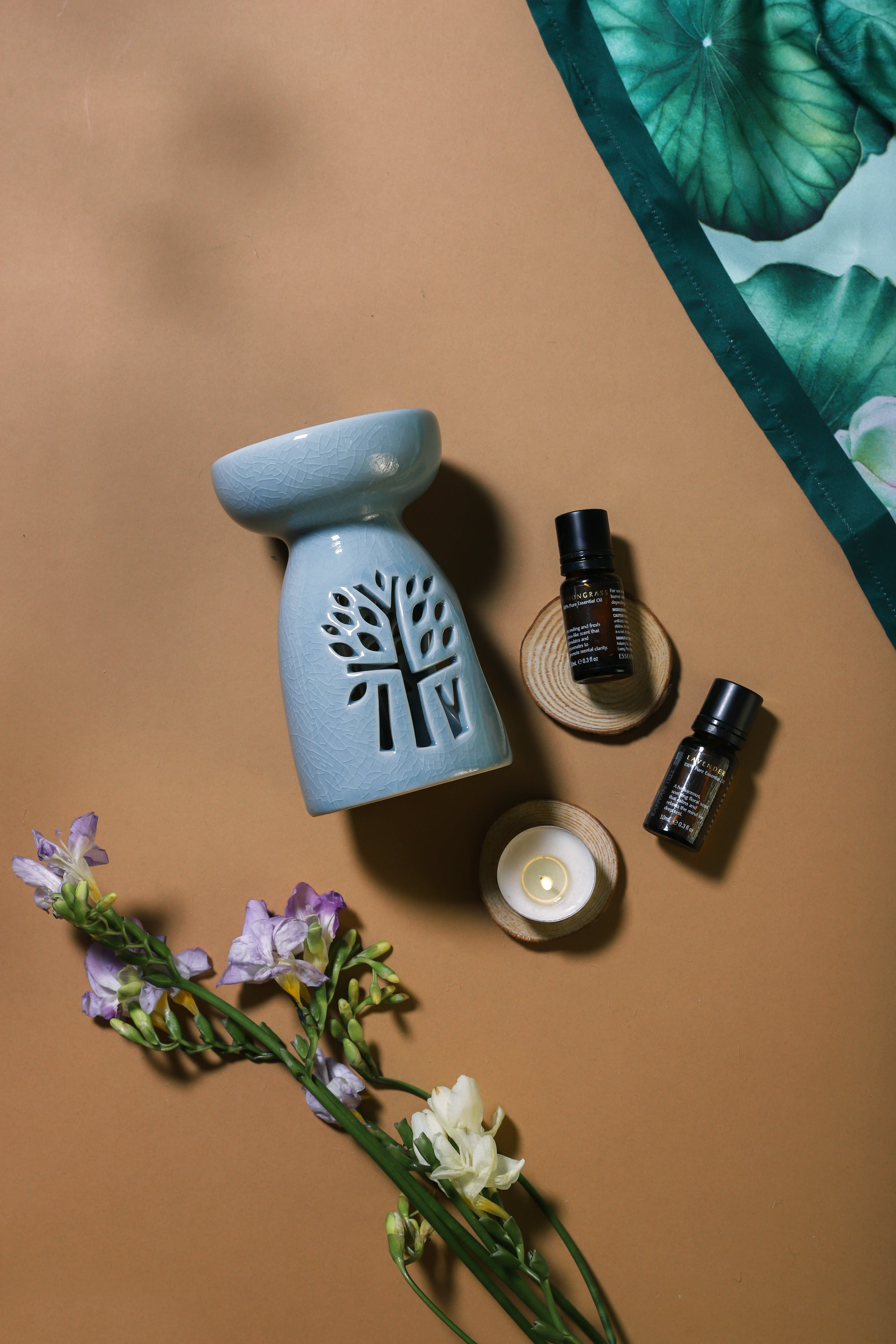 Aromatherapy set with ceramic oil burner and two essential oils styled by Banyan Tree