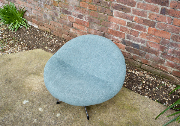 Re-upholstered swivel bucket chair