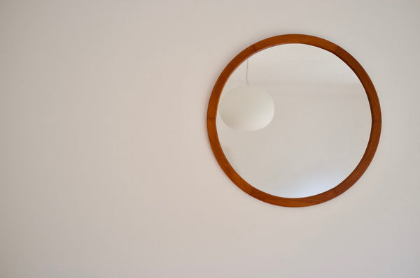 Large teak framed circular mirror