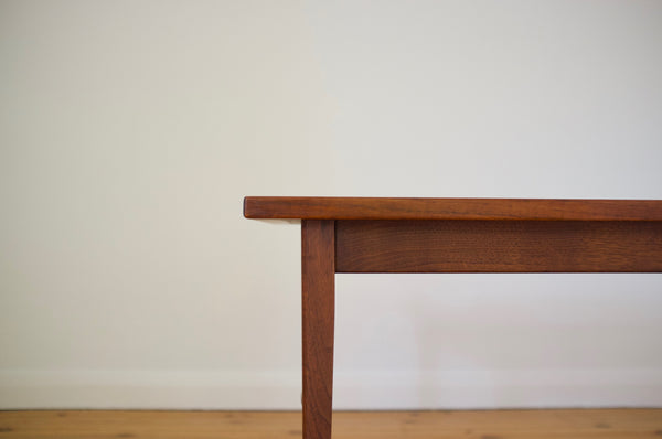 A pair of walnut end tables