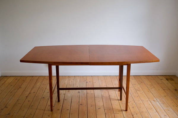 Boat-shape dining table by Paul McCobb