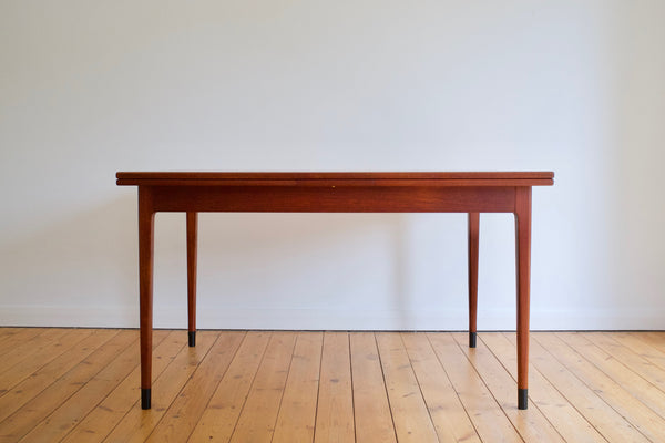 Niels Moller extending teak dining table