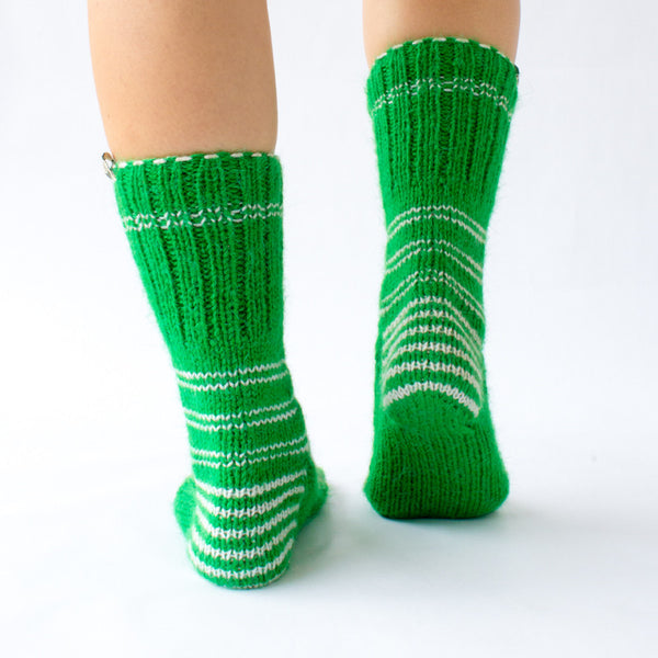green wool sock with white details and colorful Christmas pattern, handknitten, vegan and fairtrade wool sock Christmas edition for men and women back view