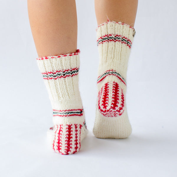 white wool sock with red and green details and pattern, handknitten, vegan and fairtrade wool sock Christmas edition for women back view