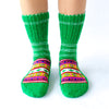 green wool sock with white details and colorful Christmas pattern, handknitten, vegan and fairtrade wool sock Christmas edition for men and women front view